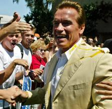 SchwarzenEGGer: Candidate Arnold takes an Egging in Long Beach from someone presumably not a fan... but with EGGs to spare!
